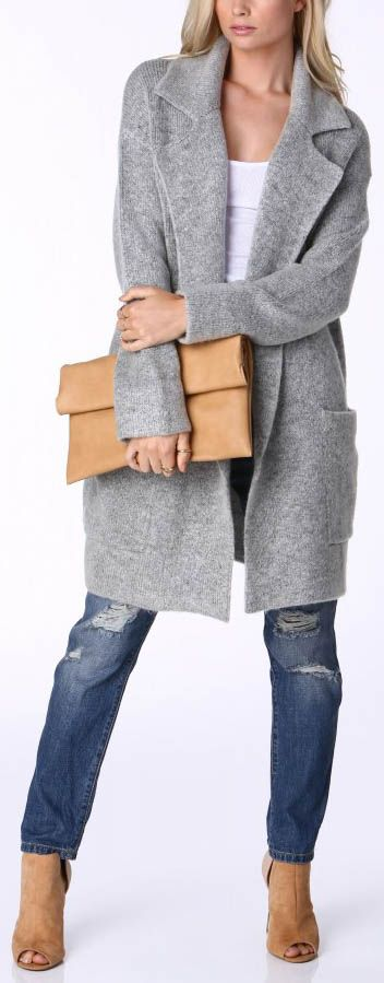 How do you not have this in your closet yet?! This knee length gray coat is a must have chic piece every girl should own! #trendy