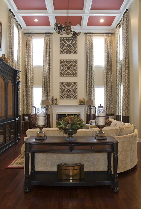 A grand great room #family #draperies...love the table in the foreground...