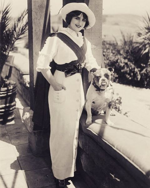 """""""Margarita Fischer at the age of twelve, was starring in her own company on the Pacific coast. Her education was not neglected despite her early debut in theatrical work, her studies as a child having been carefully supervised while she was going ahead in her profession. Her motion-picture career began with Selig. Engagements with other companies followed. She is now a leading woman for Pollard. The Other Train and The Miracle of Life are included in her latest successes."""" -- Picture-Play…"""