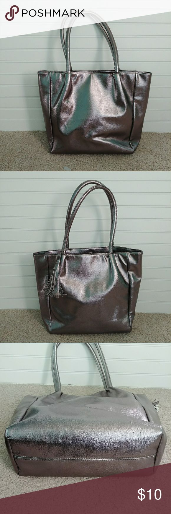 Metallic silver tote bag Ultra Chi metallic silver tote bag. 2 flaws shown in photos. Interior has no stains or tears. Bags Totes