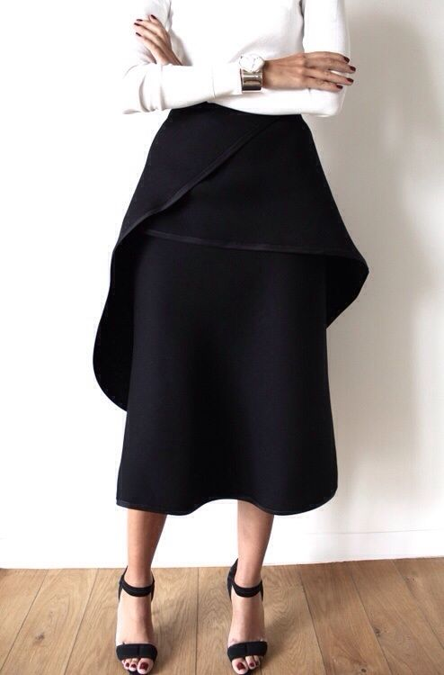 beautiful black mid length skirt with amazing detailing! Love the black and white ensemble