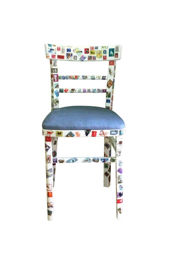 Vintage chair after renovation. For refreshing this we used a new fabric in grey color and original vintage stamps from all over the world which are sticked to the wooden construction of this chair (decoupage method).