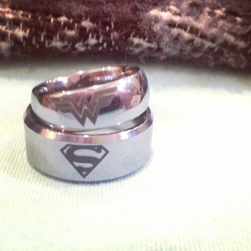 My girlfriend,zombieheartz.tumblr.com, and I recently got engaged. Here are our rings.  #Superman #WonderWoman #Engagement submitted bythechurchofcluckcluck This is wonderful! CONGRATULATIONS!