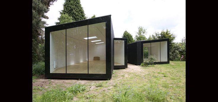 Twinned home studios built in rear garden of home in Suffolk | award winning design