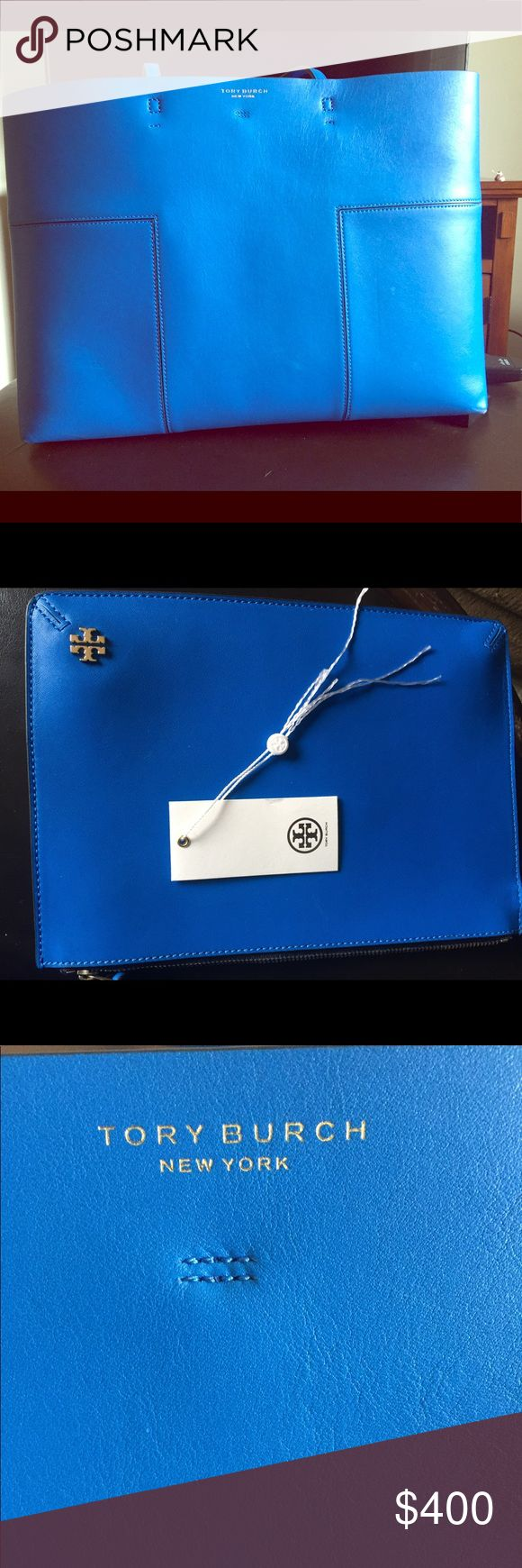 Tory Burch Cobalt Blue Bag Statement bag. Purchased in October 2017. The handbag is clean and has excellent space. (In almost brand new condition.) Comes with a dust bag (not pictured). Clutch included in the price which clips into the handbag or can be used separately. Included in list price. Fits a 15 inch MacBook. Lightly used. Tory Burch Bags Totes