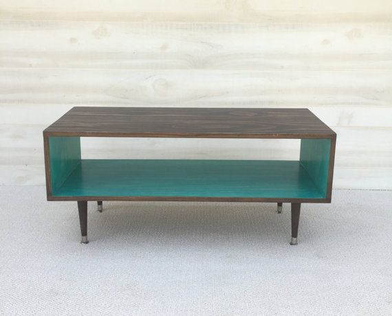 Coffee Table - Mid Century Modern Coffee Table in Chocolate and Teal  Coffee Table Pictured L 40 x W 16 x H 16 Shelving Space: 8.5 x 16  This handcrafted Mid Century Modern coffee table is made from Pine Select. Its finished with homemade stain and several protective coats of satin polyurethane. This piece can easily be customized to the size and color combination you choose!  This coffee table is a custom order and will be shipped in 2-3 weeks of payment. Variations of colors are welcomed…
