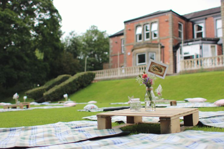 Picnic on the lawn, pallet tables and picnic rugs. Perfect July wedding!