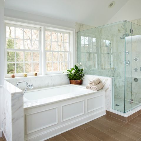 Love the Layout Design of the shower and tub. White furnishing and dark wood floors