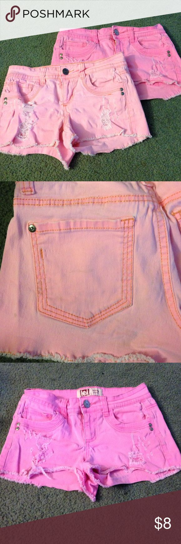 Bundle of juniors shorts Gently used. In great condition. One is peach and has a couple spots as shown in the pictures above. And the other is pink which also has one spot on the pocket as shown in the picture. lei Shorts Jean Shorts