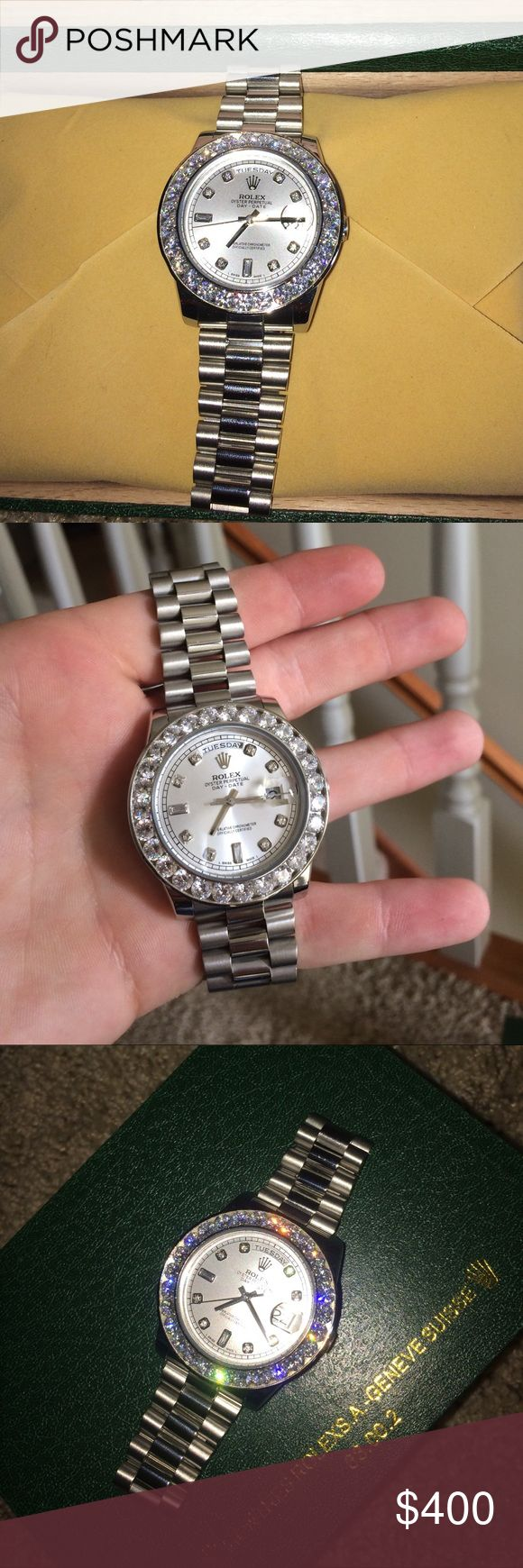 18k Plated Stainless Steel Rolex w Lab Diamonds 18k white gold plated stainless steel presidential day/date with lab simulated diamonds on the bezel. Glides and doesnt tick. Comes with box. Rolex Accessories Watches
