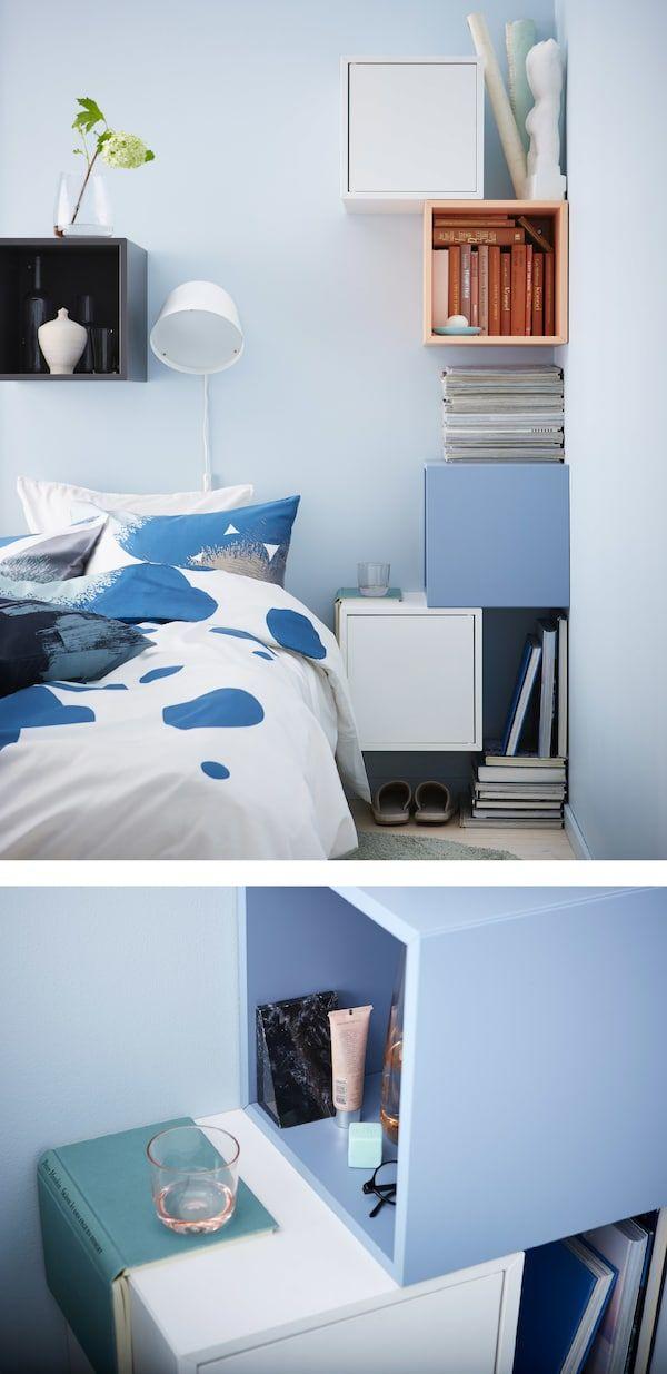 Et gjør-det-selv-nattbord laget av fargerike terningformede skap festet til veggene rundt ei seng