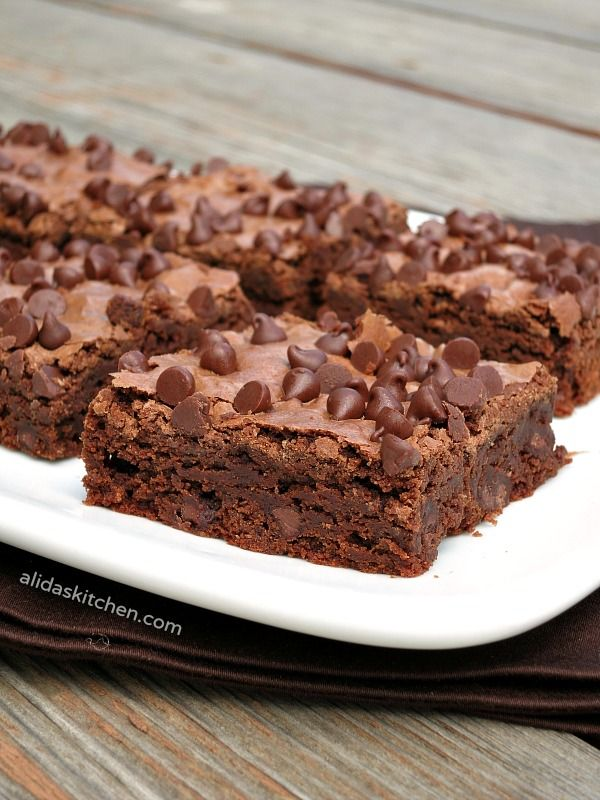 Olive Oil Fudge Brownies are an easy from scratch brownie recipe made with heart healthy olive oil instead of butter.