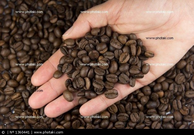http://www.photaki.com/picture-hand-with-coffee-beans_1360441.htm