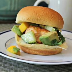 Salmon Burgers topped with Mango, Cucumber, and Avocado Salsa.