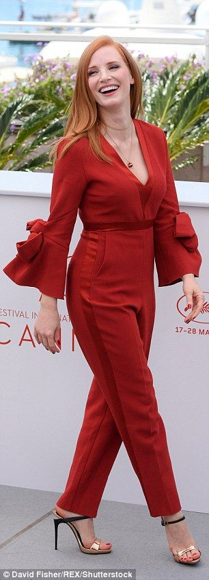 Plunging: The red-headed actress matched her russet mane with a burnt orange Florent Crepe jumpsuit from ROKSANDA