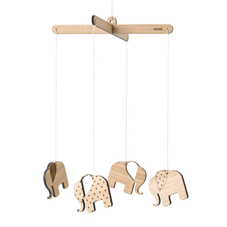 These natural wooden mobiles will compliment any childs room.   • Measures approx. 60cm long and 20.5cm wide. • Laser cut from Bluegum Veneer (Sourced from sustainable forests) • Comes fully assembled so all you have to do is hang it up and enjoy! • Can be left natural or can be painted, stained or varnished to match your home   Includes: 5 pieces (1 crossbar & 4 elephants all tied together with natural hemp cord)   *Because of the natural nature of the Bluegum Veneer colours & grain m…