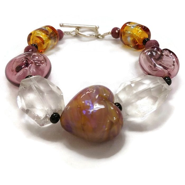 Handcrafted lampwork beads with crystal quartz.  $125 This delicate piece with made of crystal quartz beads mixed together with beautifully Canadian made glass beads.  The toogle closure is sterling silver.