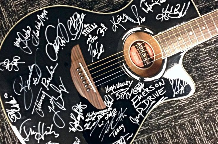 Prepping our autographed guitar for auction to benefit Canuck Place Children's Hospice #canucks #canuckplace #kids #charity #goodworks #vancouver #canada #music #countrymusic #guitar #country