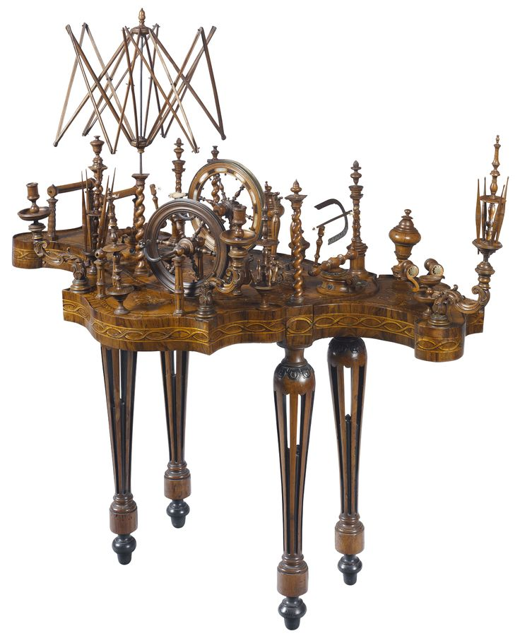 """butterfly-shaped spinning/sewing table 