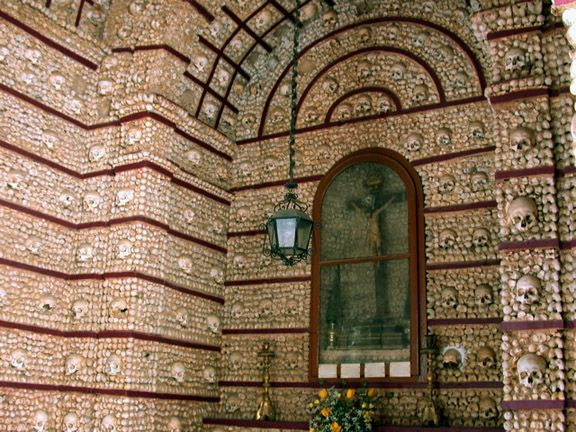 About The Igreja Real de São Francisco (Royal Church of St. Francis) in Évora is best known for its chapel that is not for the faint of heart. In the Capela dos Ossos (Chapel of Bones), the walls a...