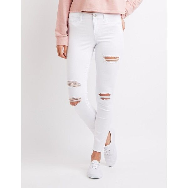 Refuge Skin Tight Legging Destroyed Jeans ($33) ❤ liked on Polyvore featuring jeans, white, distressed jeans, ripped zipper jeans, low rise jeans, white skinny jeans and white ripped skinny jeans