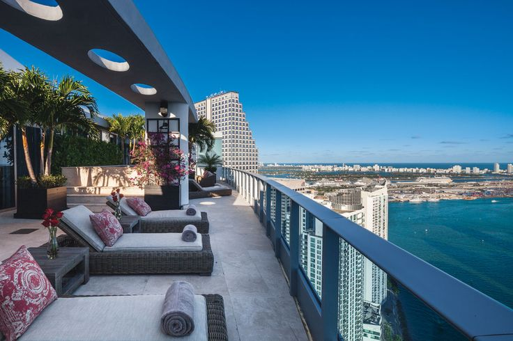 This Contemporary Penthouse In Miami's Epic Is Framed By Nature's Magnificent Panorama, And Anchored With Interiors In A Palette Of Gray, Black And Red