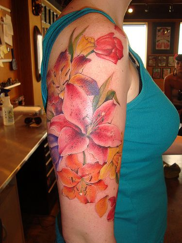 """stargazer lily, tulips, daffodils... by locustofthesea, via Flickr.""  I like the colors on this one, even though I wouldn't want a tattoo this large."