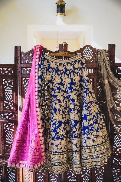 lehenga on hanger , blue lehenga on hanger , raw silk lehenga , blue and gold…