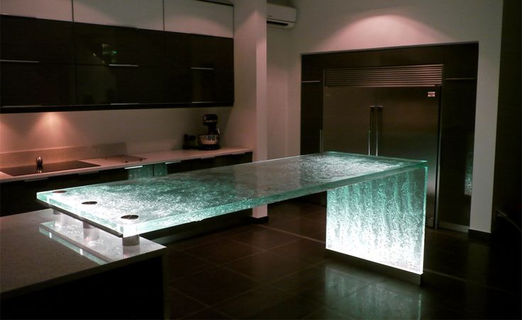 This unique kitchen countertop leaves the kitchen open and uncluttered. The glass is beautifully textured and scatters the light in a contin...