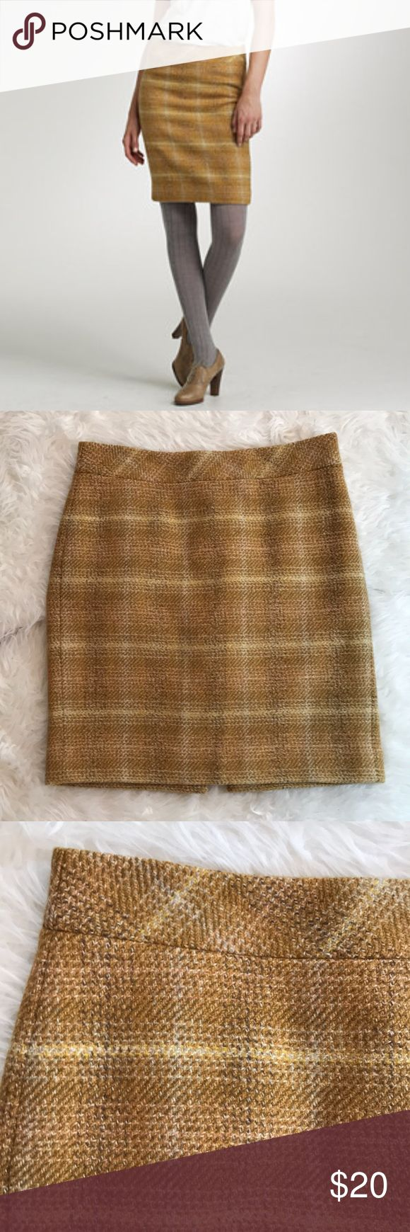 """J. Crew 'Sunnie' Golden Tweed Wool Pencil Skirt J. Crew 'Sunnie' pencil skirt in absolutely perfect condition.  The perfect cubicle-to-cocktails piece, this slimming pencil skirt is designed in an richly textured, mellow-yellow tweed.  Concealed back zipper.  Back vent.  Fully lined.  Length is about 21.5,"""" waist is approximately 34."""" 100% wool; lining is 100% polyester.  Size 12. J. Crew Skirts Pencil"""