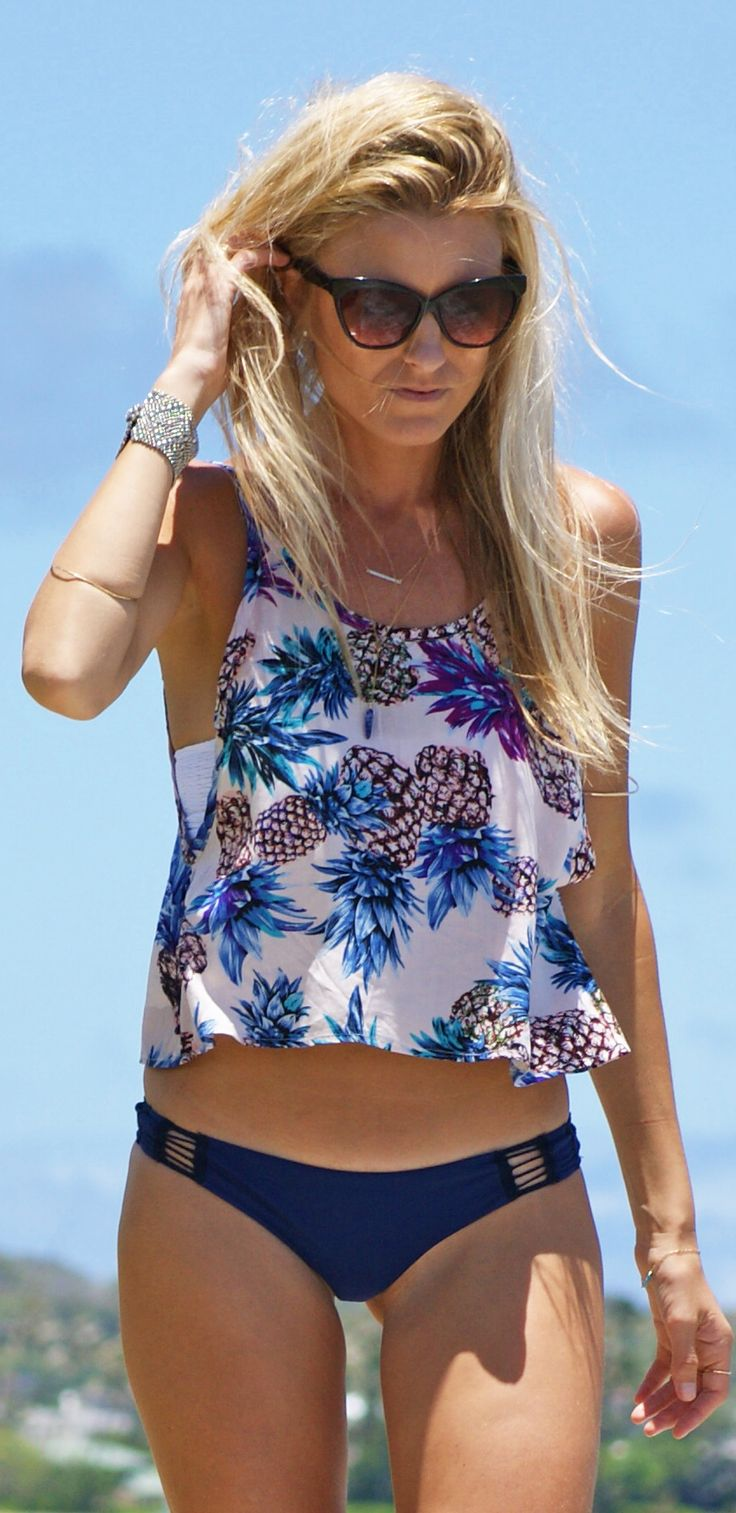 Lightweight and flowy, this effortless crop top features an open scoop back, perfect for those hot summer days.  To help get your best fit, this piece features adjustable straps.  We love to finish the look with either high-waisted shorts, a cute maxi skirt, or just our bikini bottoms when at the beach.