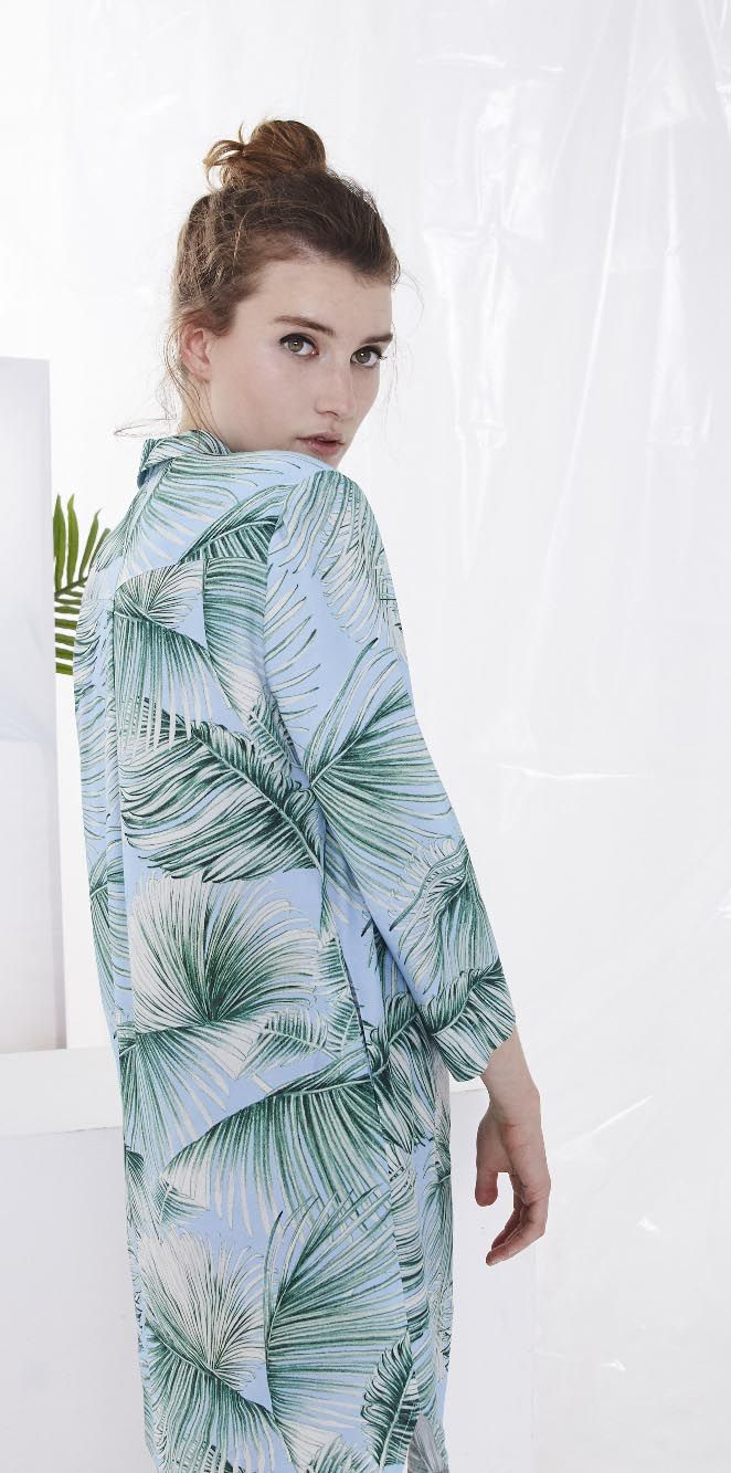 Digital lush green leaves decorate this easy-to-wear shirt dress, bringing a tropical vibe to the city.