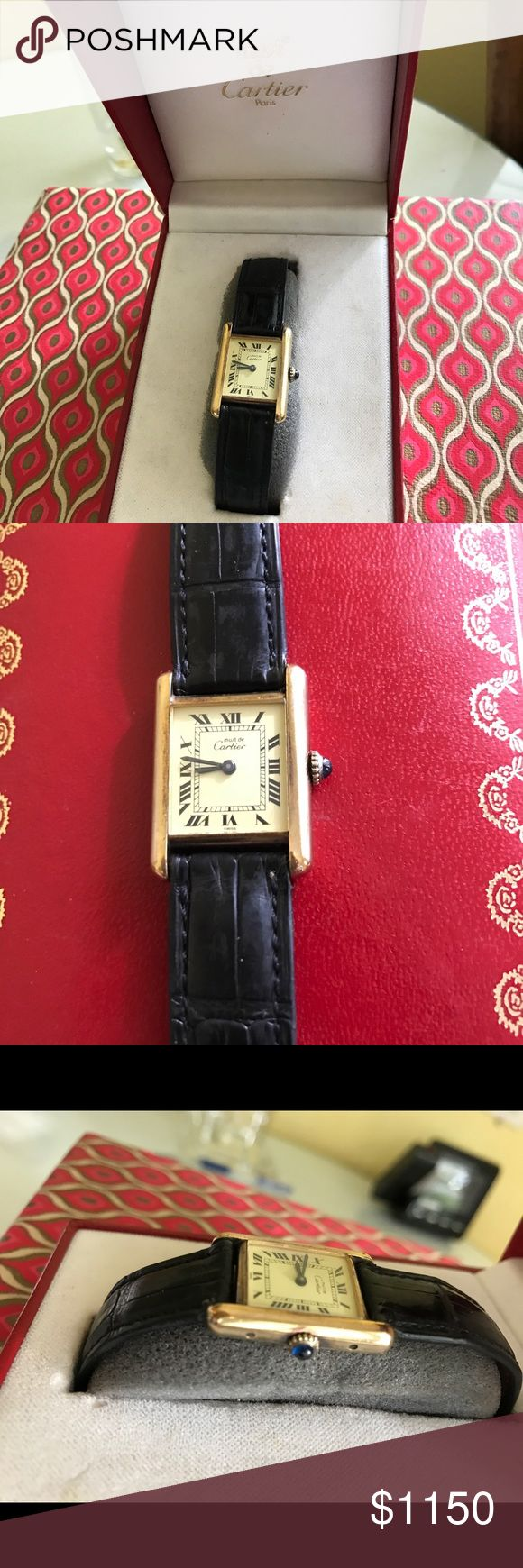 Vintage Authentic Cartier Tank Watch Ladies' 18K yellow gold plated sterling silver Cartier Tank Must de Cartier Watch with smooth bezel, black Roman numeral hour markers, blue-steeled sword hands, brown leather strap and 18K yellow gold-plated stainless steel tang buckle closure. Comes with its Cartier box and I Purchased the Cartier alligator strap several years ago for $250. Cartier Accessories Watches