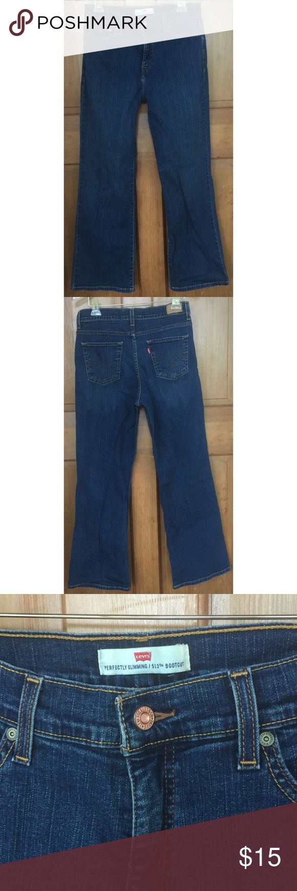 """Levi's 512 Perfect Slimming Boot Stretch Jeans 12 Pair of Levi 512 Perfectly Slimming bootcut jeans, 12 S/C. Nice overall condition. Laying flat they measure approximately:                                    Waist: 14.5, Rise 10"""", Inseam: 28"""". Thanks!! Levi's Jeans Boot Cut"""