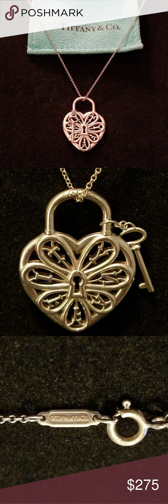 """Tiffany & Co. Filigree Heart Necklace Authentic Tiffany & Co. sterling silver 925 filigree heart with key pendant necklace for sale.  The chain is 18"""" long. The heart is approximately 1"""" wide. This was originally purchased at the Tiffany & Co. store at South Coast Plaza and has since been retired by Tiffany & Co. Please excuse the lighting in the photos, the necklace is indeed sterling silver. It was only worn a few times and is in excellent condition. Tiffany & Co. Jewelry Necklaces"""