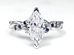 MARQUISE ENGAGEMENT RING with twisted sapphire and diamond set band
