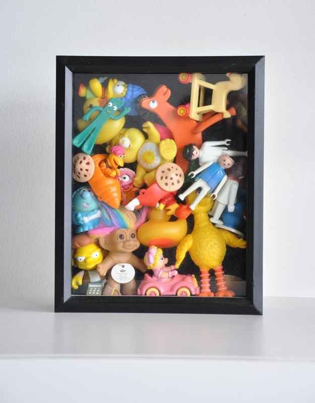 Can't bear to part with your child's old toys? Keep them out of the way (and on display) in a shadow box.