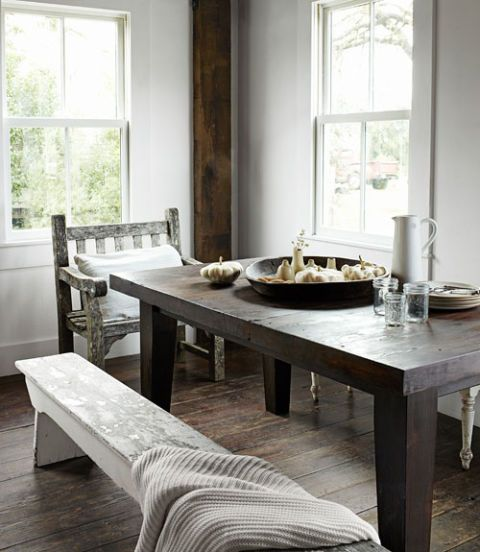In this northern California home's dining room, a Smith & Hawken chair and two wooden benches provide seating at a table that the homeowner made. The fir floorboards were reclaimed from a pea-shelling barn.