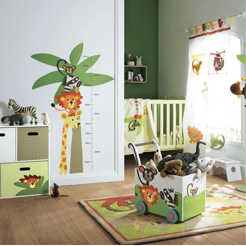 [1]A contemporary jungle safari baby's nursery.  It's a perfect theme for theme for a little boy. The look has been achieved by coordinating jungle bedding, cot mobile and decor accessories. The mobile storage chest keeps clutter at bay. The white furniture suite harmonises the overall style. [1] http://www.babydeco.co.uk/jungle-safari-nursery/hideseek/