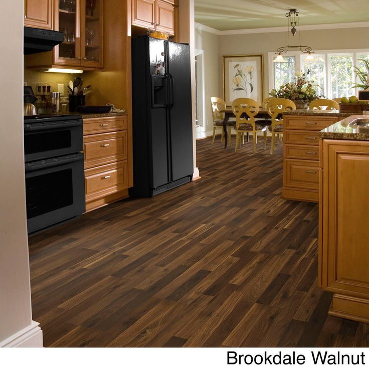 Transform your home's interior with Woodford Crimson laminate flooring from Shaw Industries. With its lifelike woodgrain pattern, this flooring offers the beauty of hardwood floors without the cost or