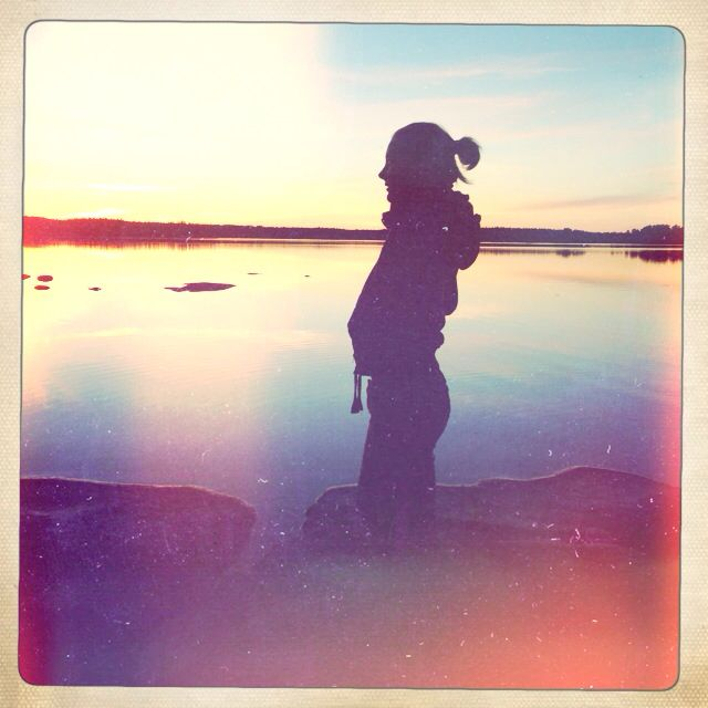 My sister, summernight, shadows, setting sun. Auringonlasku.