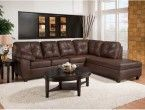 Small dark brown leather sectional sofa with chaise with coffee table