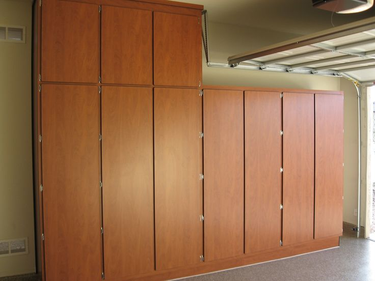 Try your own Google Search for FREE GARAGE CABINETS PLANS Mount the cabinet to the wall Shelving and