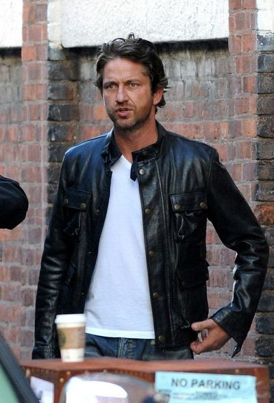 Gerard Butler in a black leather jacket