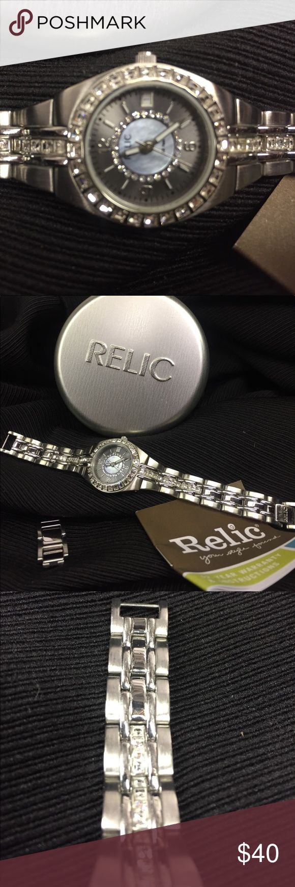 Relic watch, sterling silver Relic watch with rhinestone bezel around the face and 1/2 way down both sides of the band. There are NO stones missing and has 2 extra links that can easily be added for length Jewelry