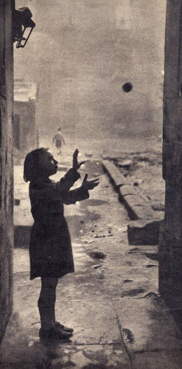 Bert Hardy - A young girl plays in the back-court of the gorbals. broken concrete, flooded pools, heaps pf smelling rubbish and rats, 1948.