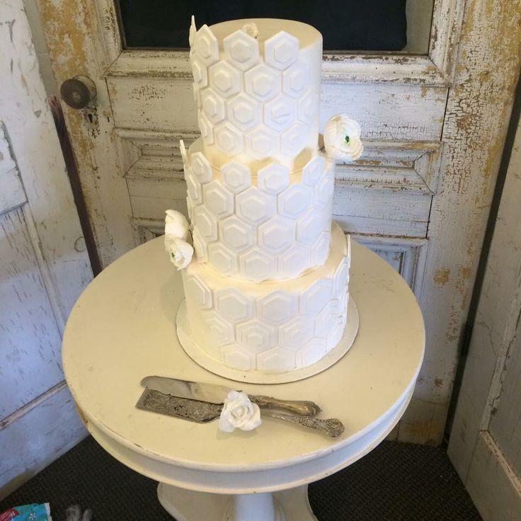 White on white wedding cake Www.ediblesins.com