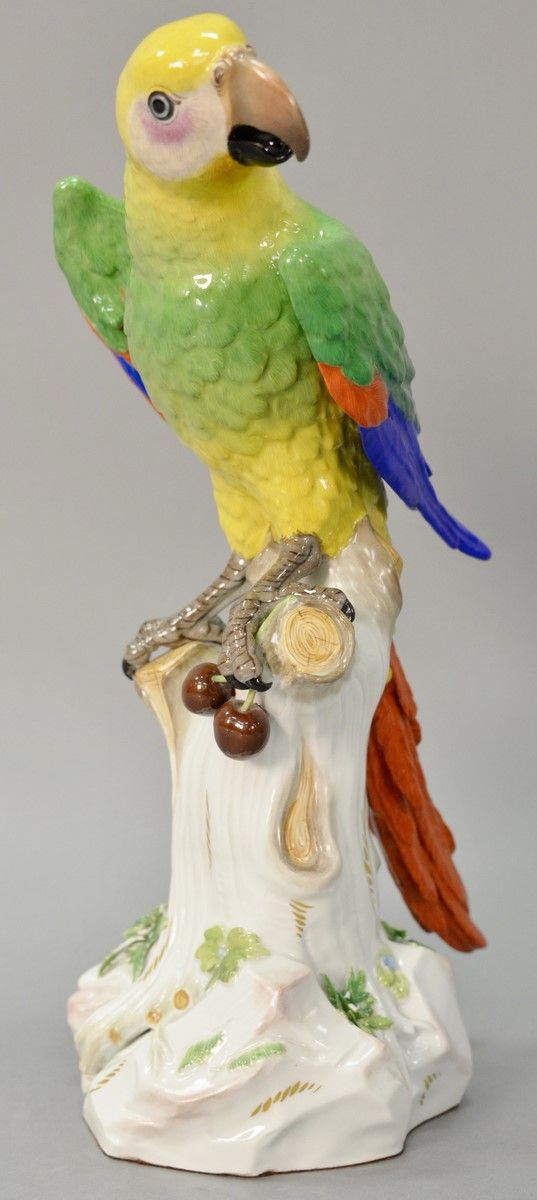 "Large Meissen porcelain parrot having bright plumage perched on a floral decorated tree stump having blue crossed swords mark ""A43A"" (having minor chips in leaves and flowers and minor chip on stump branch). ht. 16 in. ~ Realized Price $2760.00  #nadeausauction"