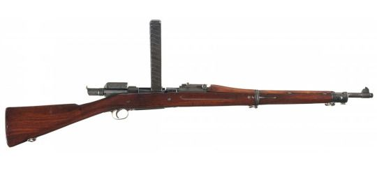 Springfield M1903 MkI rifle  Manufactured by the Springfield Arsenal c.1903-1918 and converted to use the Pedersen device - manufactured by Remington - c.1918 for the planned WW1′s 1919 Allied Spring Offensive - serial number 1172141. .30-18 Automatic/7,65x20mm 40-round 45° removable stick magazine, originally a bolt action - bolt replaced by a semi-automatic pistol fitting snugly in the rifle's barrel.