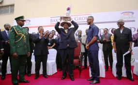 Photo:                   Maelezo/Daily News                                    Uganda President Yoweri Kaguta Museveni holds aloft a bunch of gifts he was presented by Bakhresa Group of Companies Chief Executive Officer, Mr Salim Aziz after completing a tour at the Bakhresa...